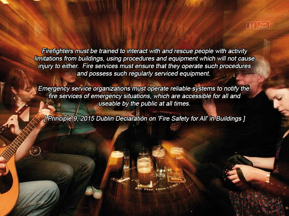 Colour photograph of a Traditional Irish Music Session, usually held at night, in one of the many, many 'pubs' (public houses) in Dublin. An assortment of traditional wind and string instruments are being played by adult men and women ... and in the centre of the group, a wood barrel with pints of the 'black stuff' and glasses of water on top.